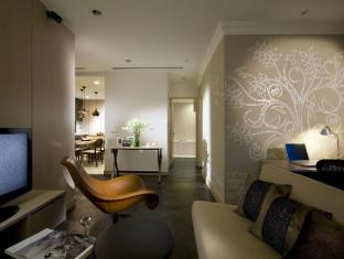 Fraser Suites Singapore Singapore - Two Bedroom Residence - Living room with kitchen, dining and work area