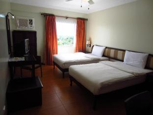 EGI Resort and Hotel Cebu - Hotellihuone