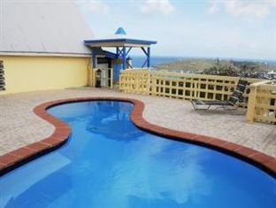 Sunset Gardens Guesthouse Hotel in ➦ Saint Thomas ➦ accepts PayPal.