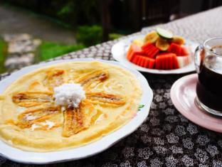 戴萨科普图普特拉普特拉民宿酒店 巴厘岛 - 餐饮