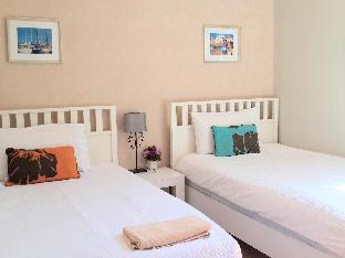 The Vimanlay Service Apartment guestroom junior suite