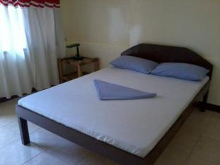 Alona Grove Tourist Inn Panglao Island - חדר שינה