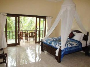 Bali Bhuana Beach Cottages באלי - חדר שינה