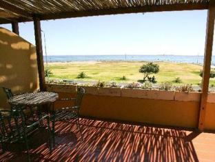 Dolphin Inn Guesthouse Cape Town - Balcony of Deluxe Suite with view to Robben Island