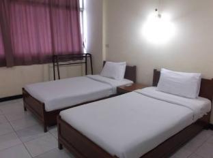 Tapee Hotel Suratthani - Gästezimmer
