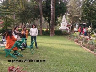Baghmara Wildlife Resort Chitwan National Park - guest enjoying garden