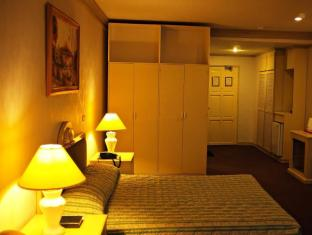 Orange Grove Hotel Davao - Chambre