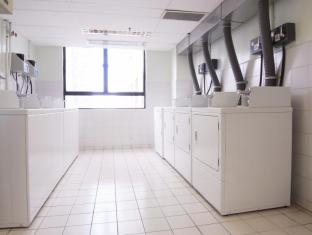B P International Hotel Hong Kong - Self-Service Laundry Room