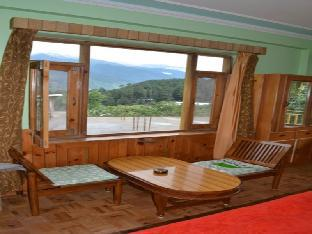 Фото отеля Bhoomi Holiday Home-Compass Cottage