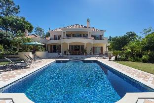 Picture Relaxing by Your Private Pool in Your Beautiful Villa in Quinta do Lago Resort  Algarve Vill