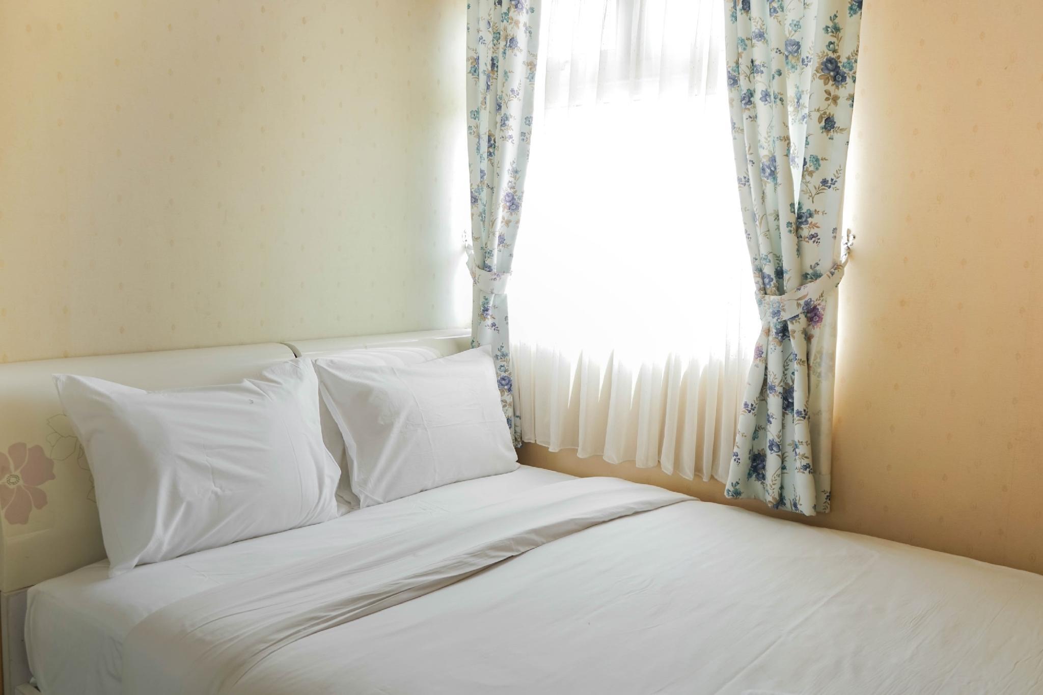 Simply 2BR Green Pramuka Apartment By Travelio