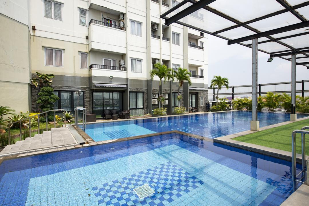 RedDoorz Apartment Near Grand City Mall
