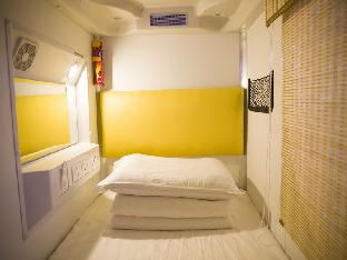 Фото отеля Shenyang Simple Capsule Hostel North Station Branch
