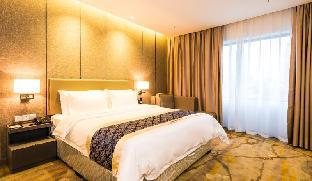 Фото отеля Zhuhai Tujia Sweetome Service Apartment Lovers Road Jingdu Building