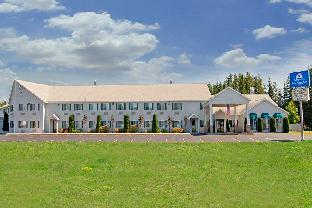 Фото отеля Americas Best Value Inn Tahquamenon Country