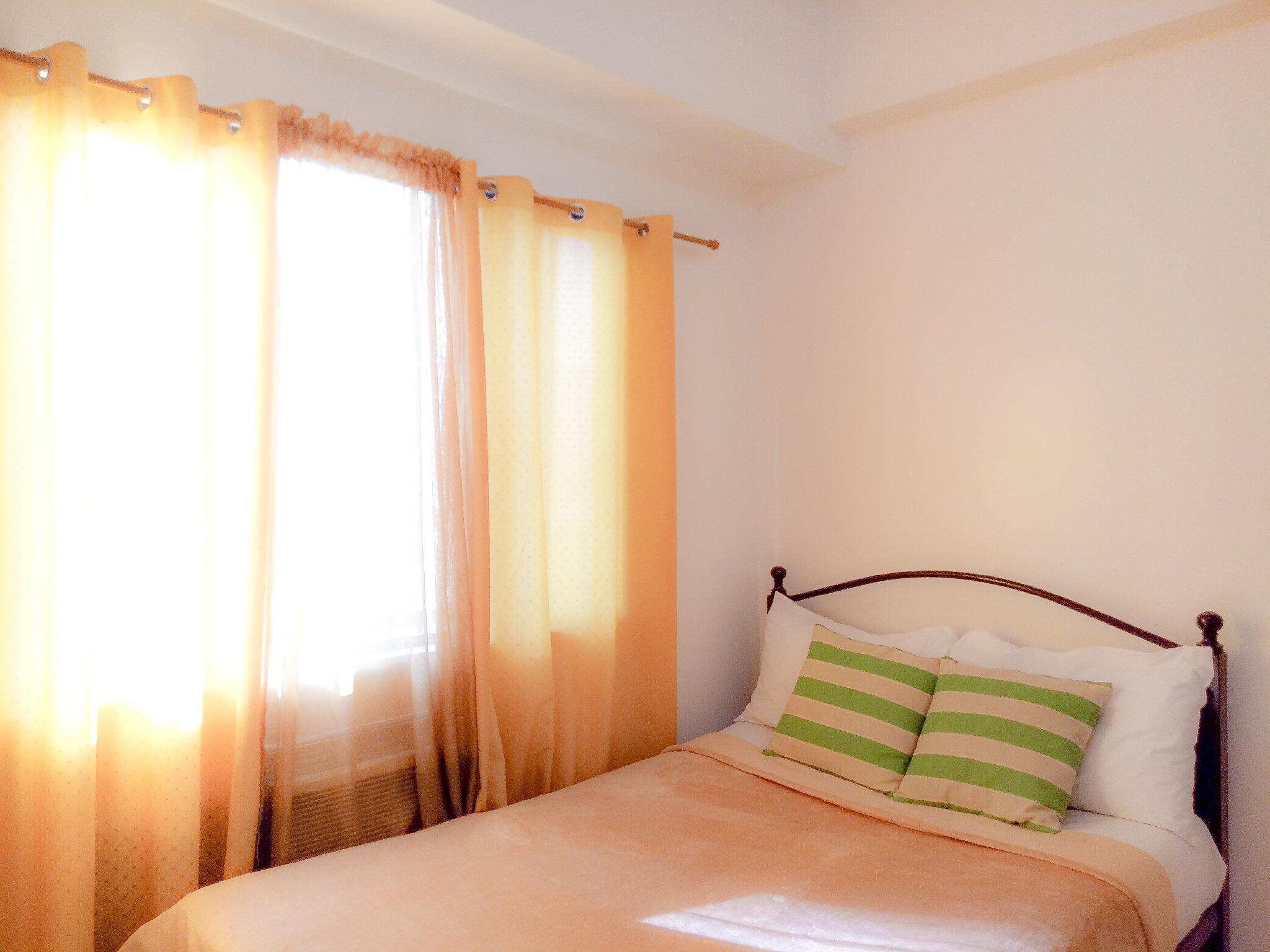 Lovely Suite BGC Center near Burgos Circle + WiFi