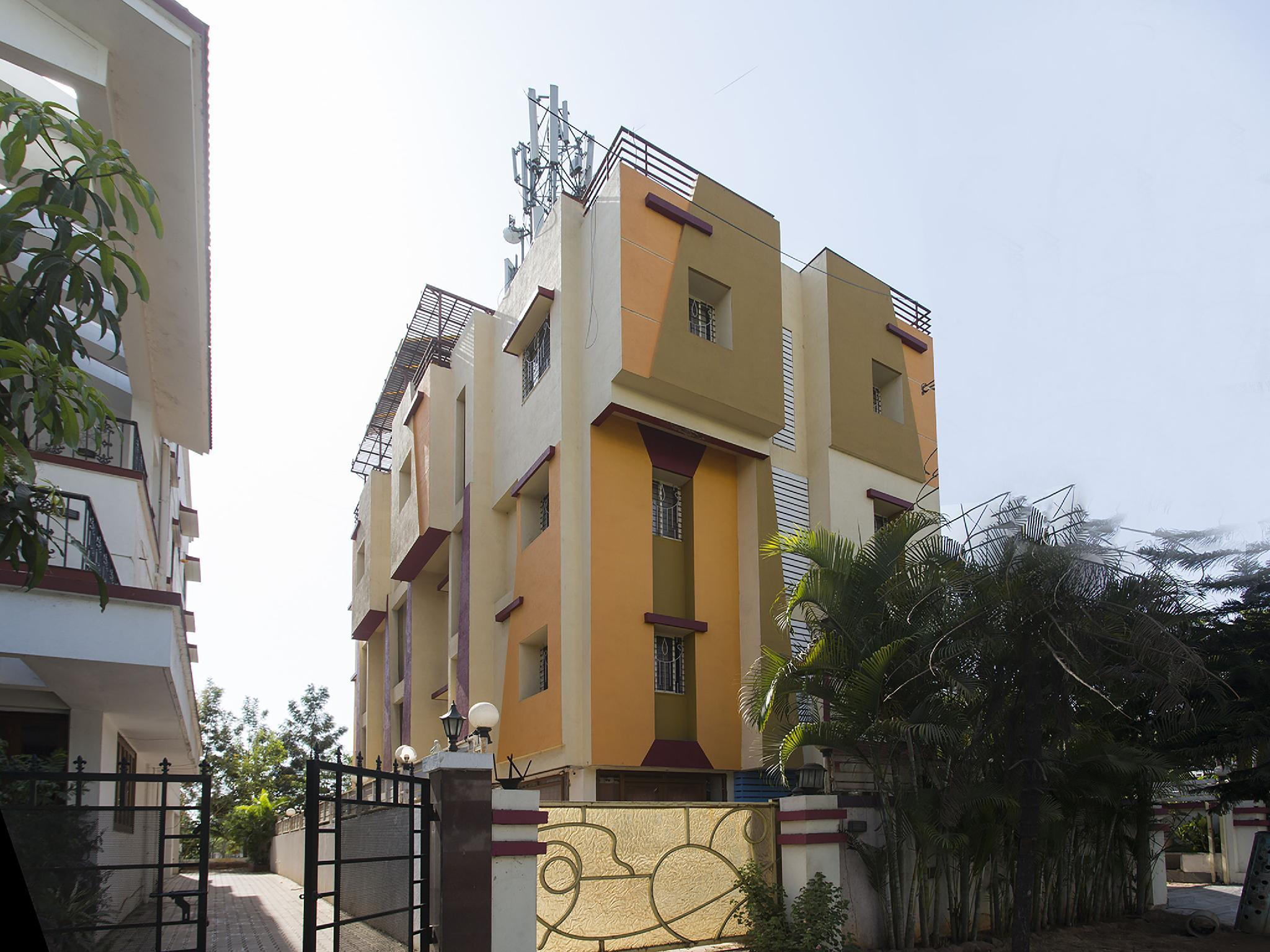 OYO 11566 Shree Swami Apartment