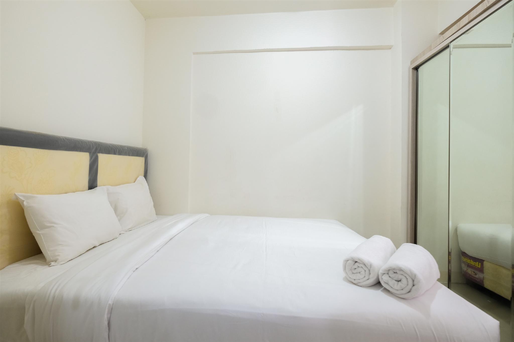 Cozy 2BR Green Pramuka Apartment By Travelio
