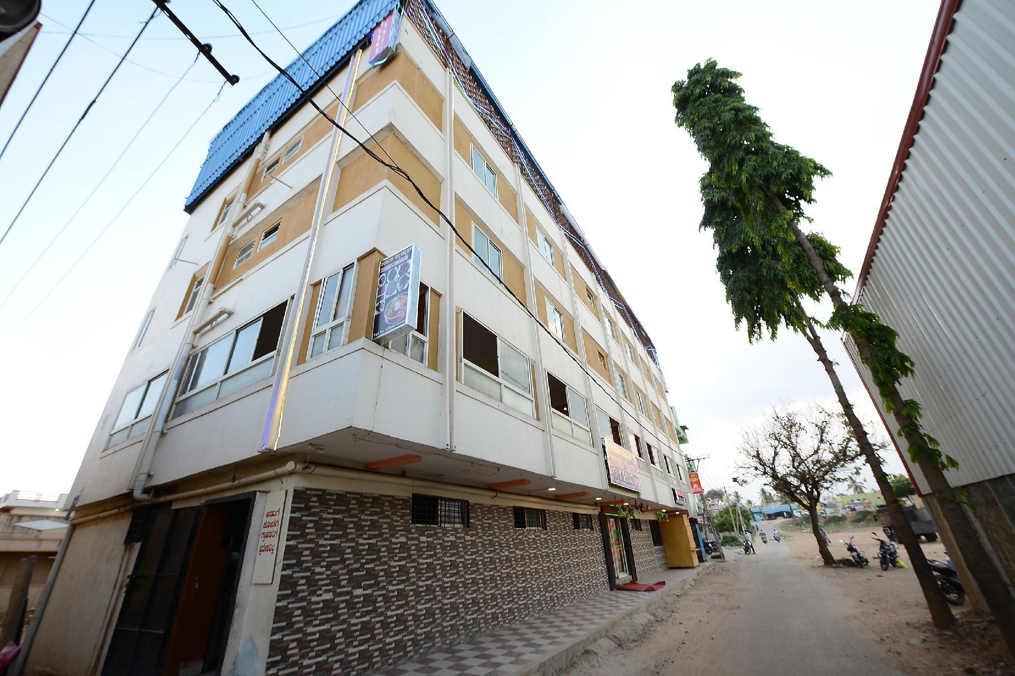 SPOT ON 37153 Karavali Paradise