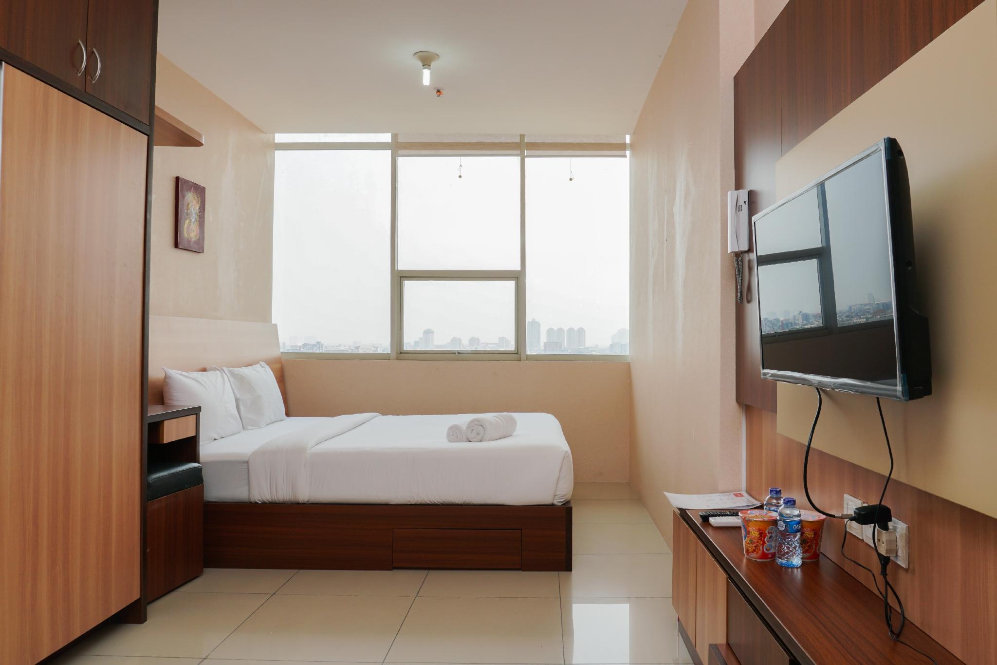 Strategic 1BR Apt @ Pasar Baru Mansion By Travelio