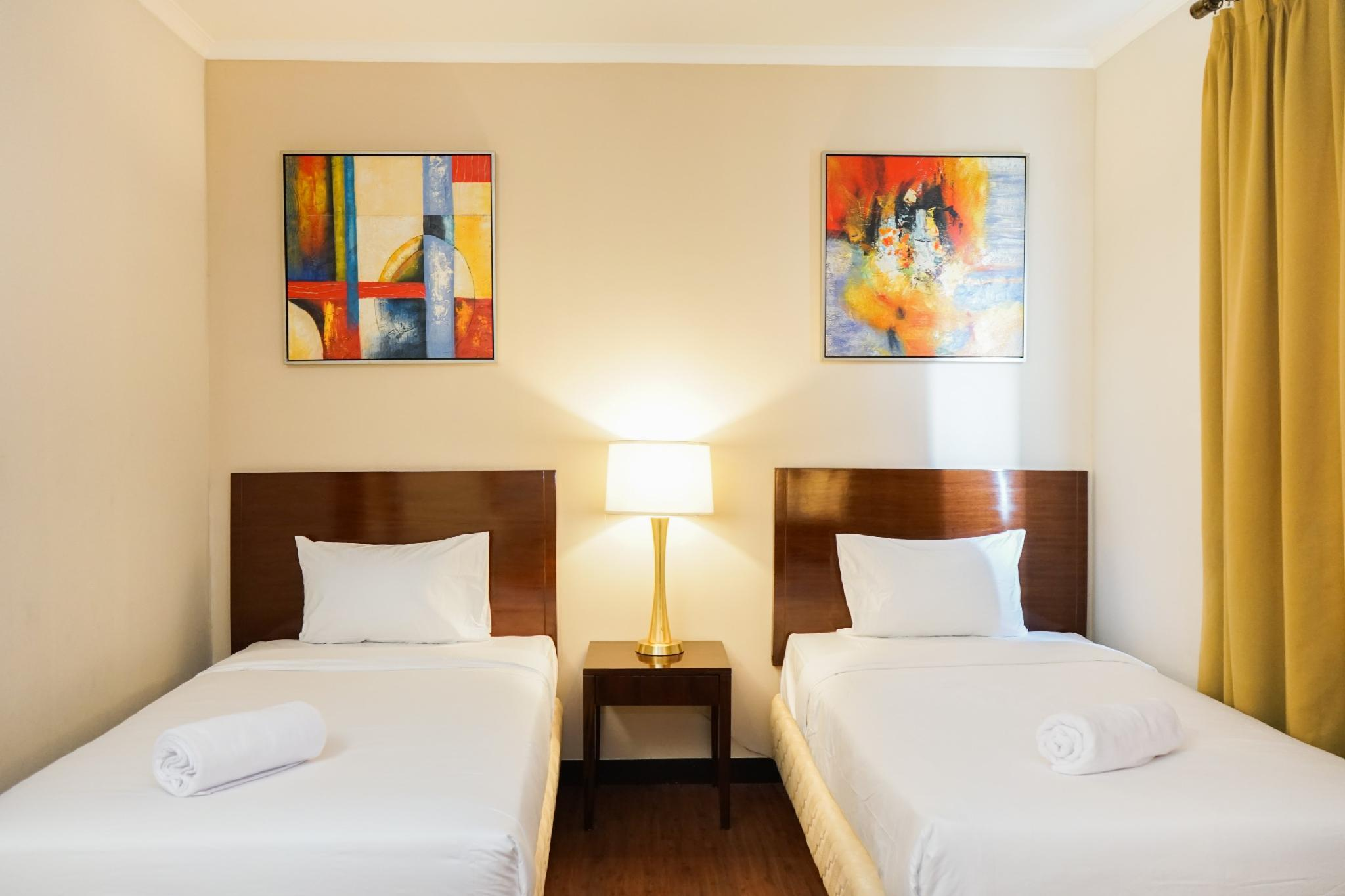 Exclusive Ancol Marina 1BR Twin Bed By Travelio