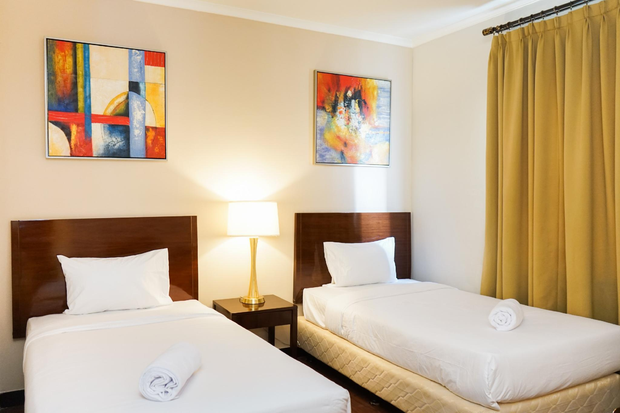 Homey Ancol Marina 1BR Twin Bed By Travelio