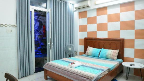 Smiley08 - Studio serviced only 1km from D1,4,7,5 Ho Chi Minh City
