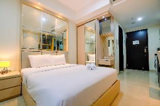 Фото отеля Minimalist with City View Studio @ Menteng Park Apartment By Travelio