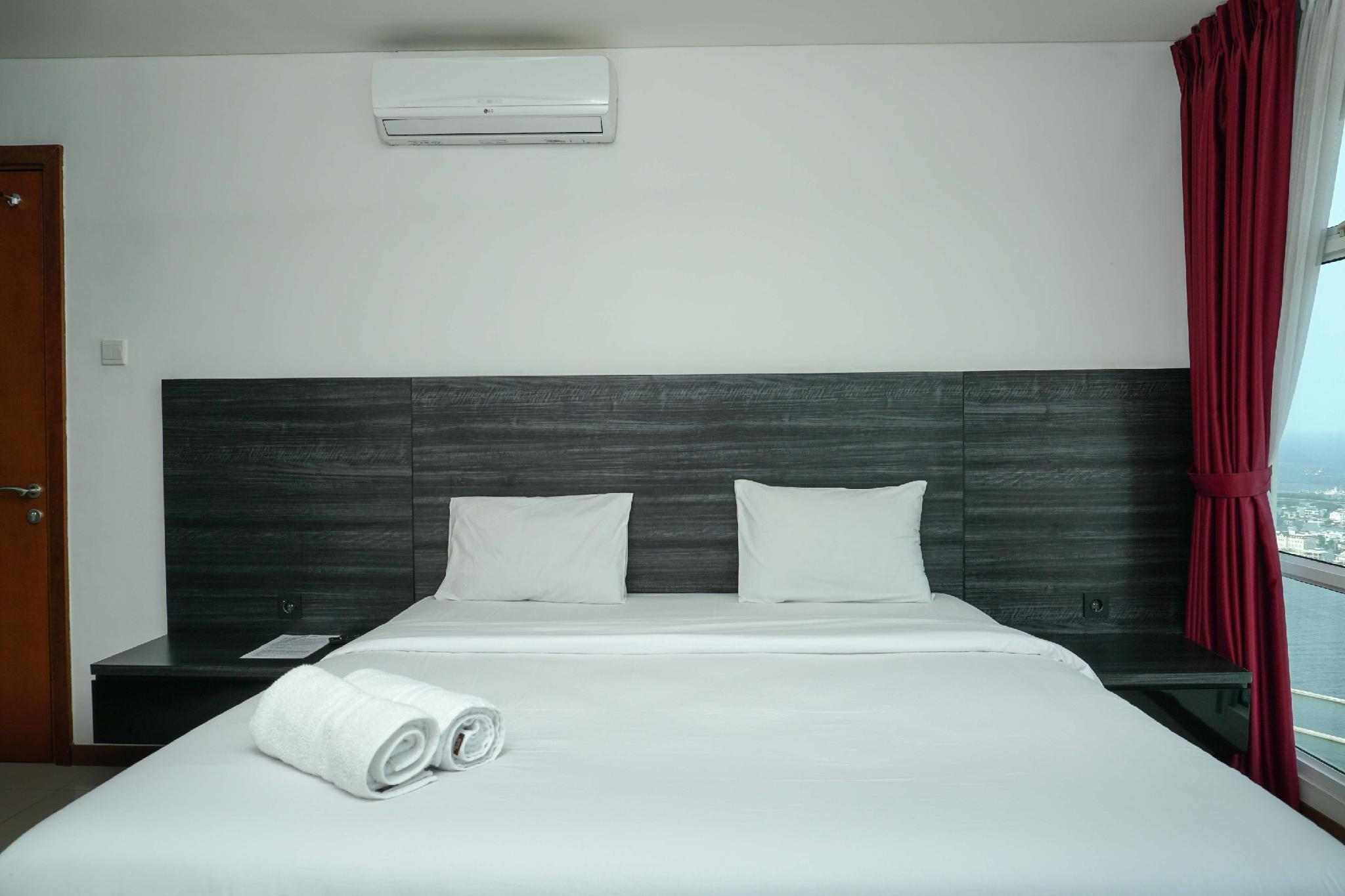 2BR Seaview Green Bay Pluit Apartment By Travelio